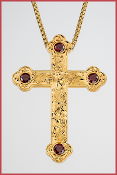 vine design gold plated cross with red faceted stones